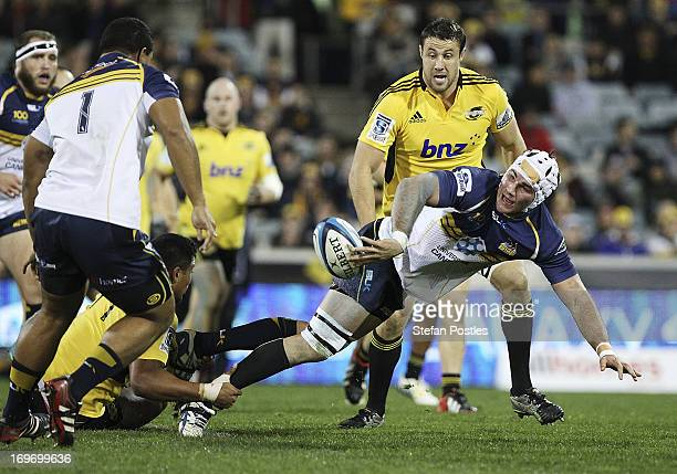 Ben Mowen of the Brumbies off loads the ball during the round 16 Super Rugby match between the Brumbies and the Hurricanes at Canberra Stadium on May...