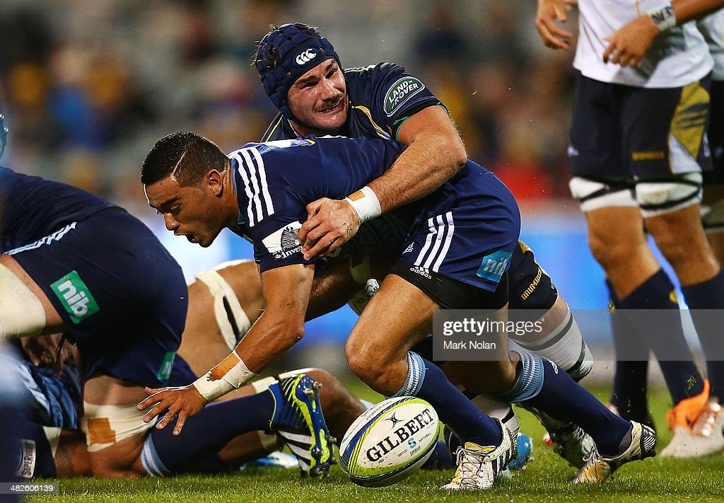 Ben Mowen of the Brumbies tackles Bryn Hall of the Blues during the round eight Super Rugby match between the Brumbies and the Bulls at Canberra Stadium on April 4, 2014 in Canberra, Australia.