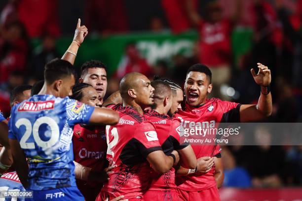Ben MurdochMasila of Tonga is mobbed by teammates after scoring a try during the 2017 Rugby League World Cup match between Samoa and Tonga at Waikato...