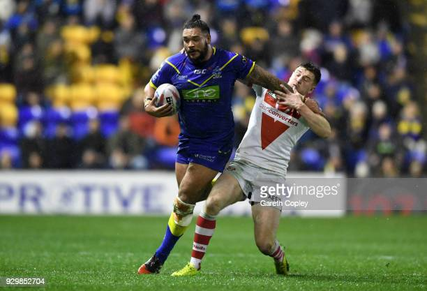 Ben Murdoch-Masila of Warrington is tackled by Mark Percival of St Helens during the Betfred Super League between Warrington Wolves and St Helens on...
