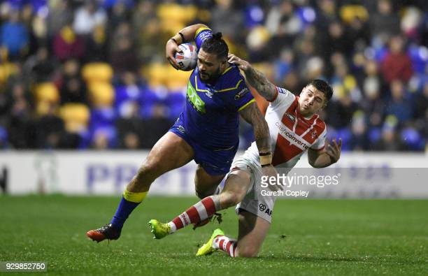Ben MurdochMasila of Warrington is tackled by Mark Percival of St Helens during the Betfred Super League between Warrington Wolves and St Helens on...