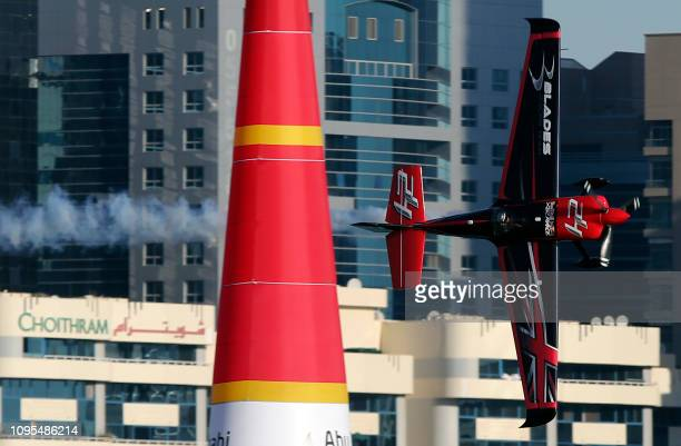 Ben Murphy of the United Kingdom manoeuvres his plane during the qualifying round of the Red Bull Air Race World Championship in the Emirati capital...