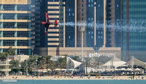 Ben Murphy of United Kingdom manoeuvres his plane during a training session for the 2019 Red Bull Air Race World Championship in the Emirati capital...