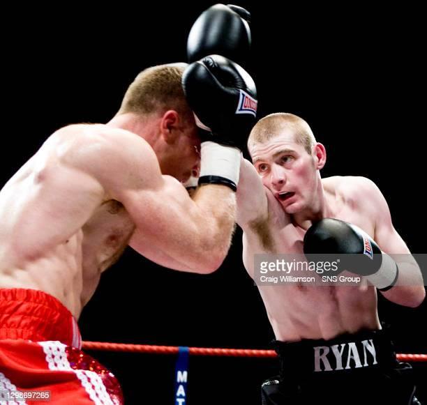 Ben MURPHY v Ryan BRAWLEY .KELVINHALL - GLASGOW.Ben Murphy is forced to defend as Ryan Brawley continues his offensive
