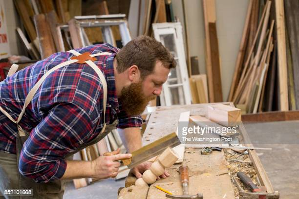 Ben Napier star of HGTV's Home Town demonstrates handmortising a table leg at Scotsman Co woodshop in Laurel MS HGTV one of the nation's top five...