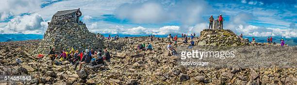 Ben Nevis summit crowds of hikers on mountain Highlands Scotland