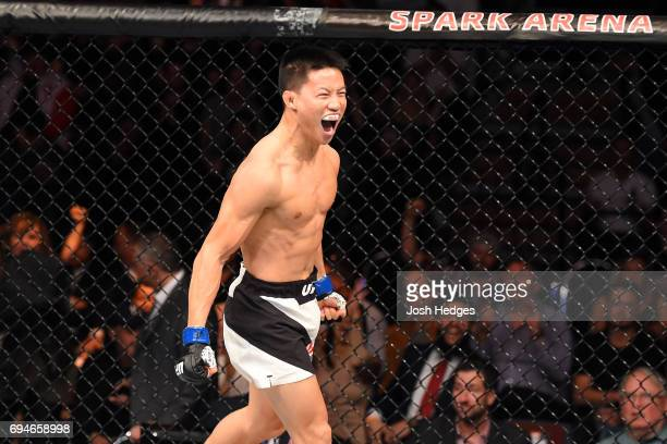 Ben Nguyen celebrates after submitting Tim Elliott in their flyweight fight during the UFC Fight Night event at the Spark Arena on June 11, 2017 in...