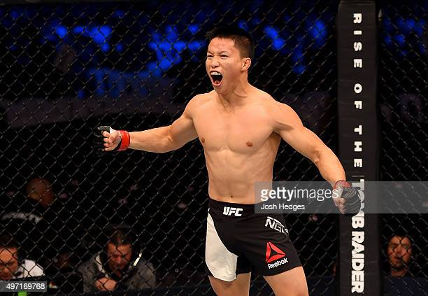 Ben Nguyen celebrates his win by submission due to rear naked choke against Ryan Benoit in their flyweight bout during the UFC 193 event at Etihad...