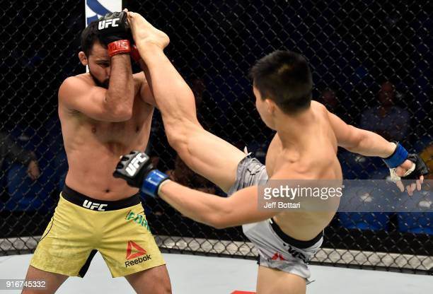 Ben Nguyen kicks Jussier Formiga of Brazil in their flyweight bout during the UFC 221 event at Perth Arena on February 11, 2018 in Perth, Australia.