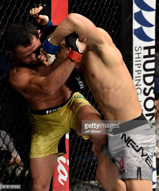Ben Nguyen punches Jussier Formiga of Brazil in their flyweight bout during the UFC 221 event at Perth Arena on February 11, 2018 in Perth, Australia.