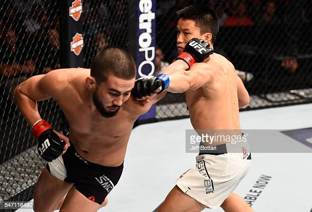 Ben Nguyen punches Louis Smolka in their flyweight bout during the UFC Fight Night event on July 13, 2016 at Denny Sanford Premier Center in Sioux...