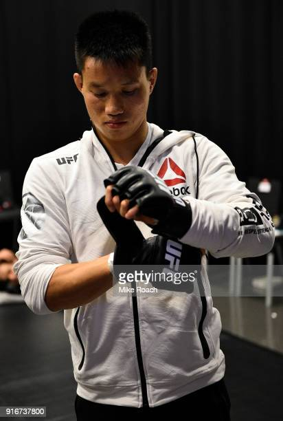 Ben Nguyen puts on his gloves backstage during the UFC 221 event at Perth Arena on February 11, 2018 in Perth, Australia.