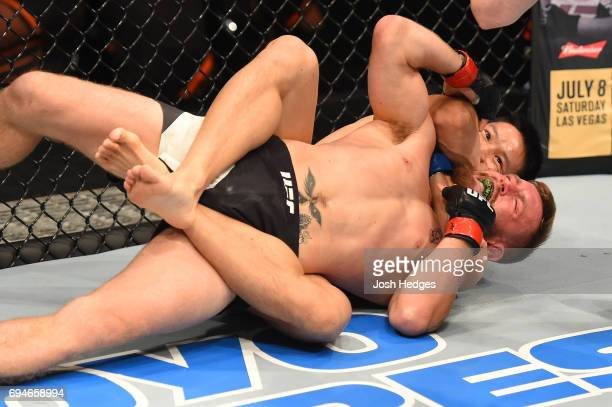 Ben Nguyen submits Tim Elliott in their flyweight fight during the UFC Fight Night event at the Spark Arena on June 11, 2017 in Auckland, New Zealand.