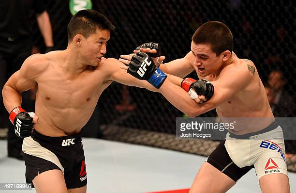 Ben Nguyen throws a punch against Ryan Benoit in the first round of their flyweight bout during the UFC 193 event at Etihad Stadium on November 15,...