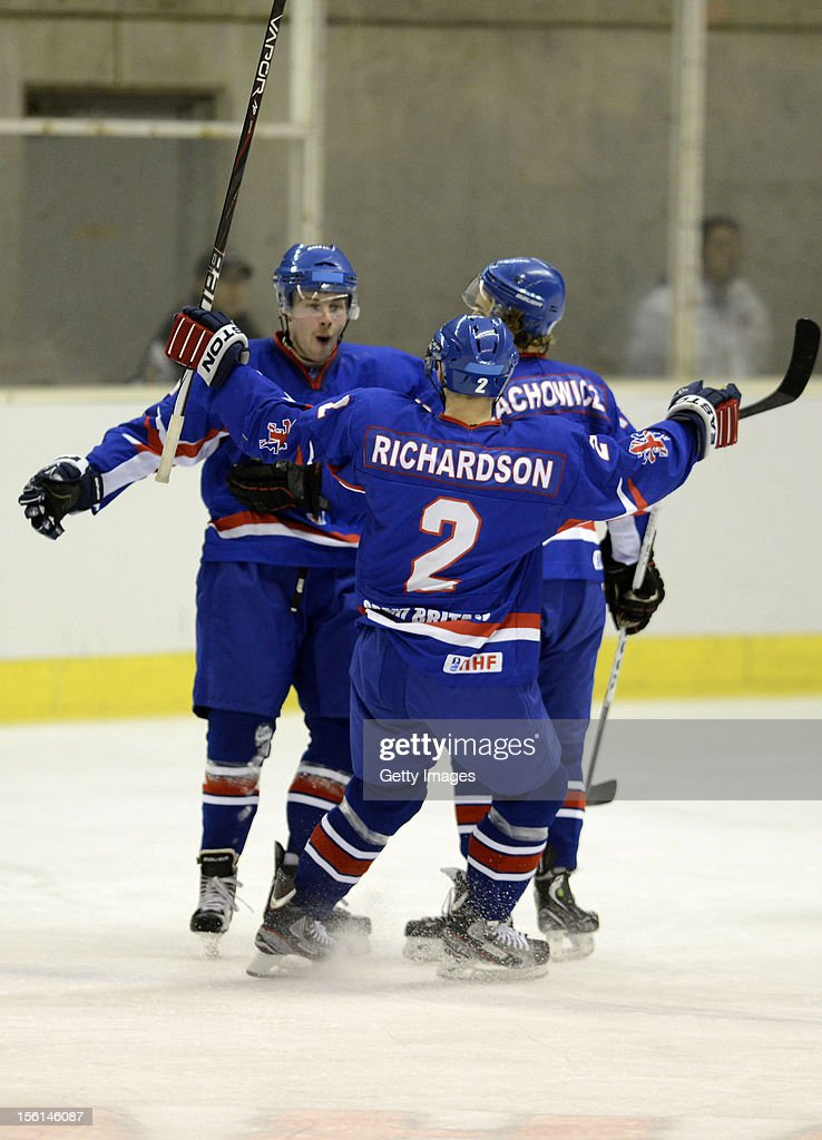 Ben O'Connor (L) #17 of Great Britain celebrates scoring the second goal with his team mates Mark Richardson #2 and Robert Lachowicz #15 during the Ice Hockey Sochi Olympic Pre-Qualification Group J match between Japan and Great Britain at Nikko Kirifuri Ice Arena on November 11, 2012 in Nikko, Tochigi, Japan. Great Britain won 2-1 and went through to the final qualification.