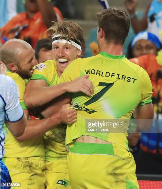 Ben O'Donnell of Australia celebrates a try in the final against South Africa during day three of the Sydney World Rugby Sevens Series tournament in...