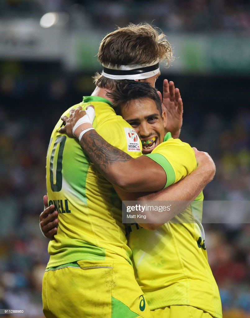 Ben O'Donnell of Australia (L) celebrates with Maurice Longbottom (R) after scoring a try in the Men's final match against South Africa during day three of the 2018 Sydney Sevens at Allianz Stadium on January 28, 2018 in Sydney, Australia.