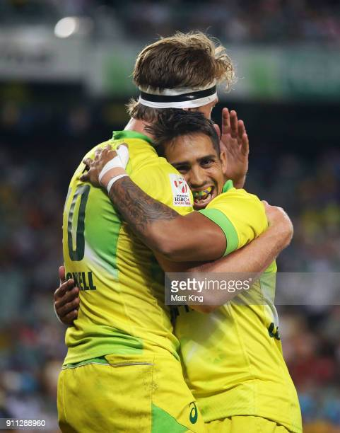 Ben O'Donnell of Australia celebrates with Maurice Longbottom after scoring a try in the Men's final match against South Africa during day three of...