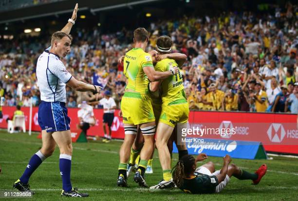 Ben O'Donnell of Australia celebrates with team mates after scoring a try in the Men's final match against South Africa during day three of the 2018...