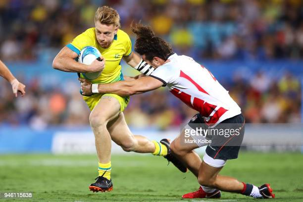 Ben O'Donnell of Australia is tackled during the Rugby Sevens match between Australia and England on day 10 of the Gold Coast 2018 Commonwealth Games...