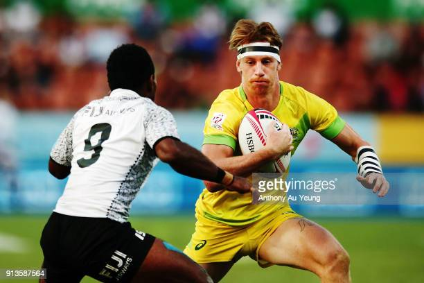 Ben O'Donnell of Australia makes a run at Jerry Tuwai of Fiji during the 2018 New Zealand Sevens at FMG Stadium on February 3 2018 in Hamilton New...