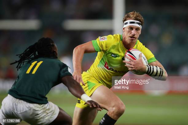 Ben O'Donnell of Australia runs with the ball in the Men's final match against South Africa during day three of the 2018 Sydney Sevens at Allianz...