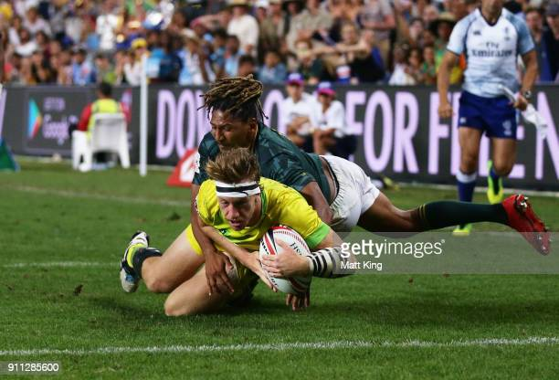 Ben O'Donnell of Australia scores a try in the Men's final match against South Africa during day three of the 2018 Sydney Sevens at Allianz Stadium...