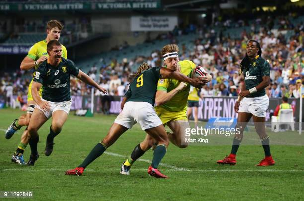Ben O'Donnell of Australia takes on the defence in the Men's final match against South Africa during day three of the 2018 Sydney Sevens at Allianz...