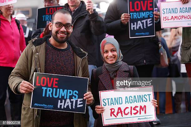 Ben O'Keefe and Iram Ali of MoveOnorg Political Action stand outside the studios of 'Good Morning America' to broadcast messages of love dignity and...