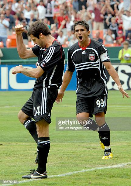 Ben Olsen left celebrates the first of three goals to help propell DC United to a 42 victory over the NY Red Bulls along with teammate Jaime Moreno