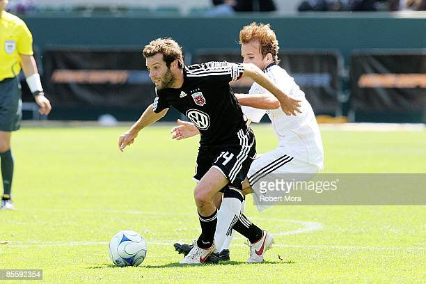 Ben Olsen of DC United looks to attack the Los Angeles Galaxy defense during the MLS game at Home Depot Center on March 22 2009 in Carson California