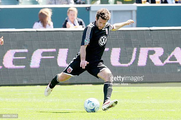 Ben Olsen of DC United makes a pass on the attack against the Los Angeles Galaxy during the MLS game at Home Depot Center on March 22 2009 in Carson...