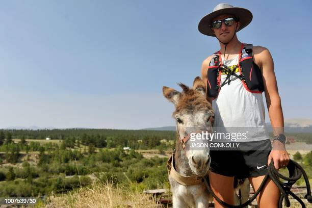 Ben Orvold of Sussex Wisconsin poses for a portrait with his burro Alice before running in the Pack Burro Race during the 70th Annual Burro Days in...