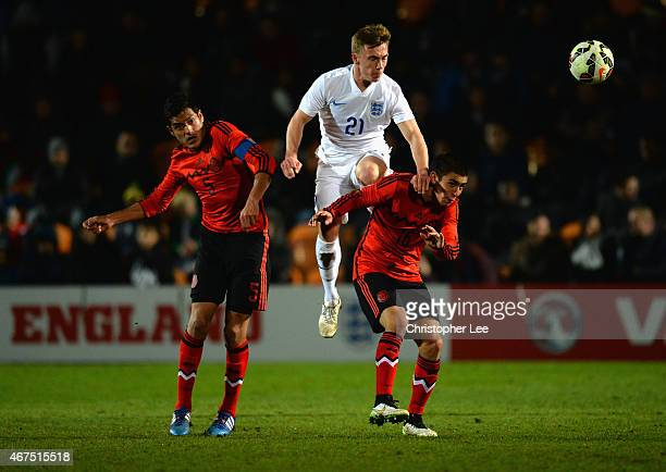 Ben Osborn of England rises above Sergio Adrian Flores Reyes and Daniel Vazquez Sosa of Mexico during the U20 International Friendly match between...