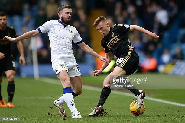 Ben Osborn of Nottingham Forest FC under pressure from Stuart Dallas of Leeds United FC during the Sky Bet Championship match between Leeds United...