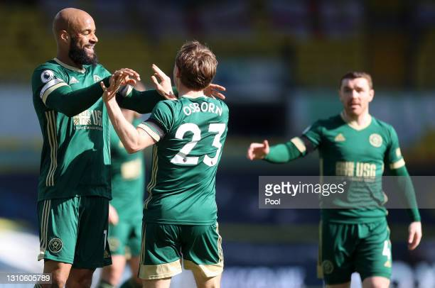 Ben Osborn of Sheffield United celebrates with team mate David McGoldrick after scoring their side's first goal during the Premier League match...