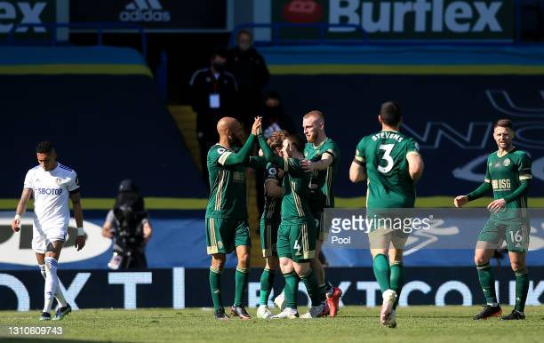 Ben Osborn of Sheffield United celebrates with teammates after scoring their team's first goal during the Premier League match between Leeds United...