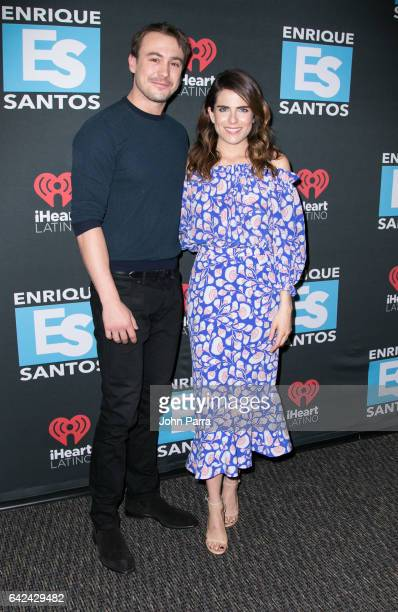 Ben O'Toole and Karla Souza visit the Enrique Santos Show at I Heart Latino Tu949 on February 17 2017 in Miami Florida