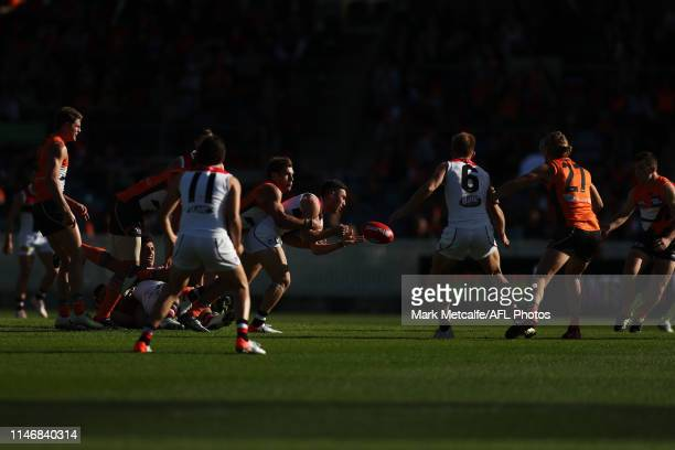 Ben Paton of the Saints handballs during the round seven AFL match between the Greater Western Sydney Giants and the St Kilda Saints at Manuka Oval...