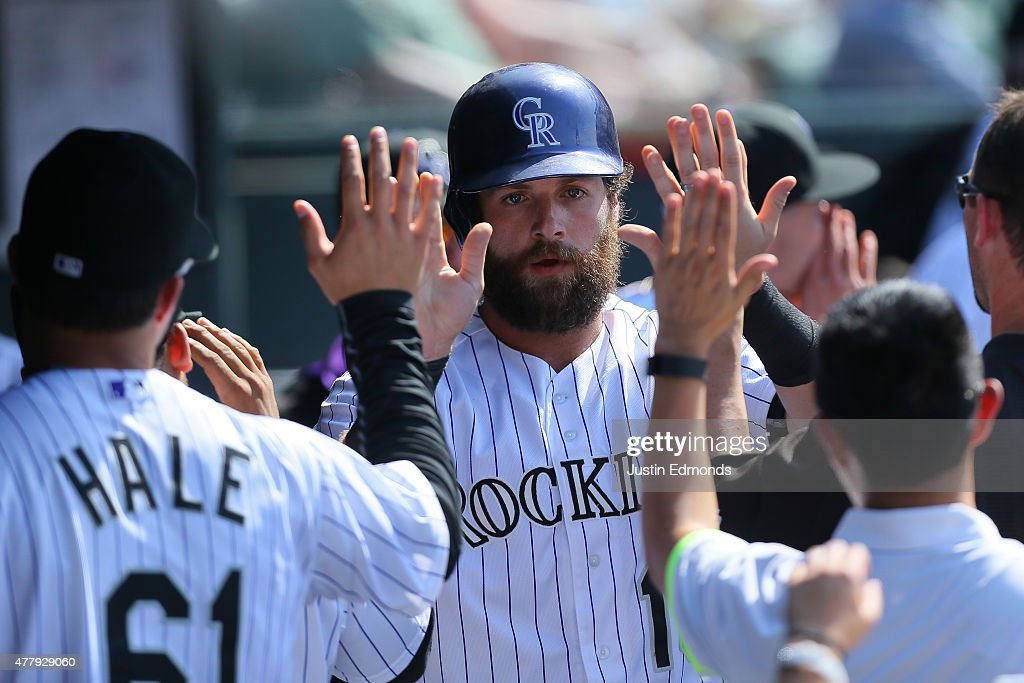 Ben Paulsen #10 celebrates in the dugout after scoring during the seventh inning against the Milwaukee Brewers at Coors Field on June 20, 2015 in Denver, Colorado. The Rockies defeated the Brewers 5-1.
