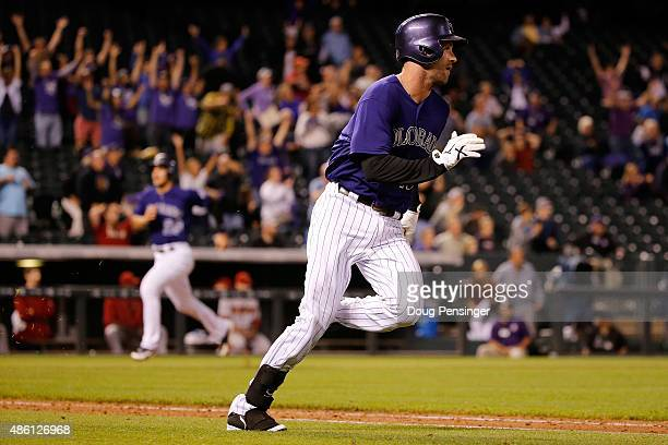 Ben Paulsen of the Colorado Rockies heads for first base on his gamewinning walkoff twoRBI single off of Matt Reynolds of the Arizona Diamondbacks as...