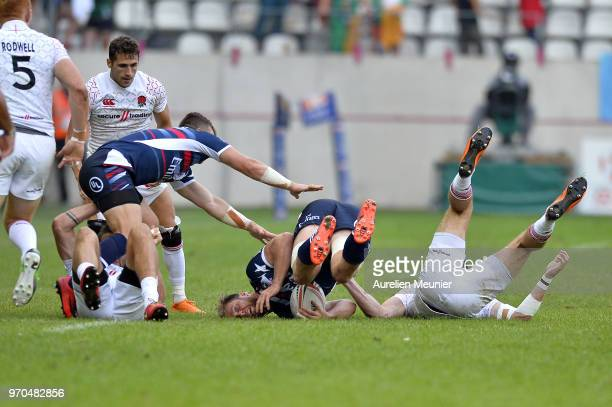 Ben Pickelman of The United States Of America is tackled during the match between England and the United States Of America at the HSBC Paris Sevens...