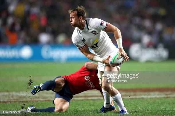 Ben Pinkelman of USA looks to pass the ball out on day one of the Cathay Pacific/HSBC Hong Kong Sevens at the Hong Kong Stadium on April 05 2019 in...