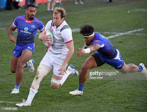 Ben Pinkleman of the United States scores a try against David Afamasaga and Tofatu Solia of Samoa during the Cup Final match of the USA Sevens Rugby...
