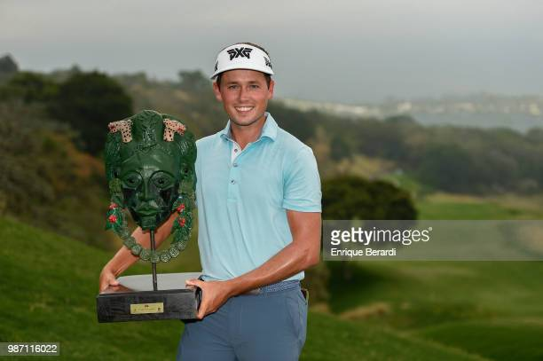 Ben Poland of the United States with the official trophy during the final round of the PGA TOUR Latinoamérica Guatemala Stella Artois Open at La...
