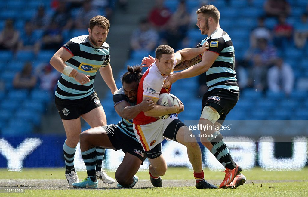 Ben Pomeroy of Catalan Dragons tries to break the london line during the Super League match between London Broncos and Catalan Dragons at Etihad Stadium on May 17, 2014 in Manchester, England.