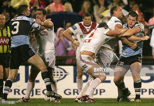 Ben Pomeroy of the Sharks fights with Aaron Gorrell of the Dragons and Paul Gallen of the Sharks fights with Shaun Timmins of the Dragons during the...