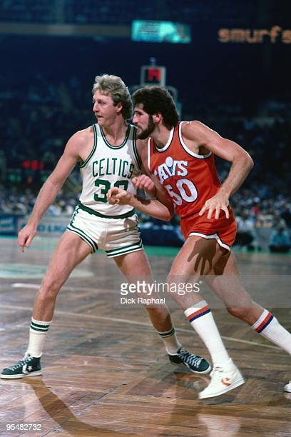 Ben Poquette of the Cleveland Cavaliers cuts to the basket against Larry Bird of the Boston Celtics during a game played in 1984 at the Boston Garden...