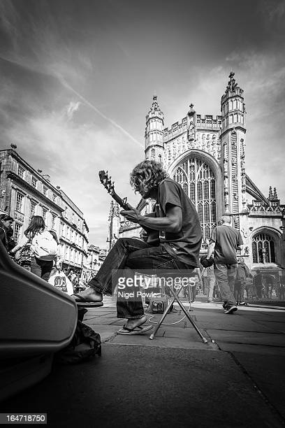 Ben Powell busking in front of Bath Abbey, Bath, UK. 1st September 2012. A Sunny day in Bath for the tourists.