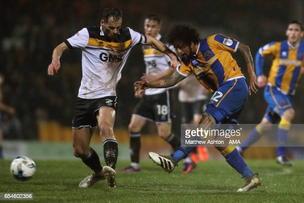 Ben Purkiss of Port Vale and Junior Brown of Shrewsbury Town during the Sky Bet League One match between Port Vale and Shrewsbury Town at Vale Park...